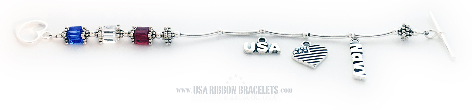 This USA-B2 Red White and Blue bracelet is shown with a Heart Toggle Clasp. They added 3 charms to their order: USA Charm, Heart Flag Charm and a Navy Charm.