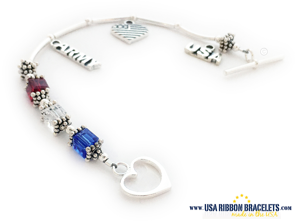 USA-B2  This USA-B2 Red White and Blue bracelet is shown with a Heart Toggle Clasp. They added 3 charms to their order: USA Charm, Heart Flag Charm and a Navy Charm.