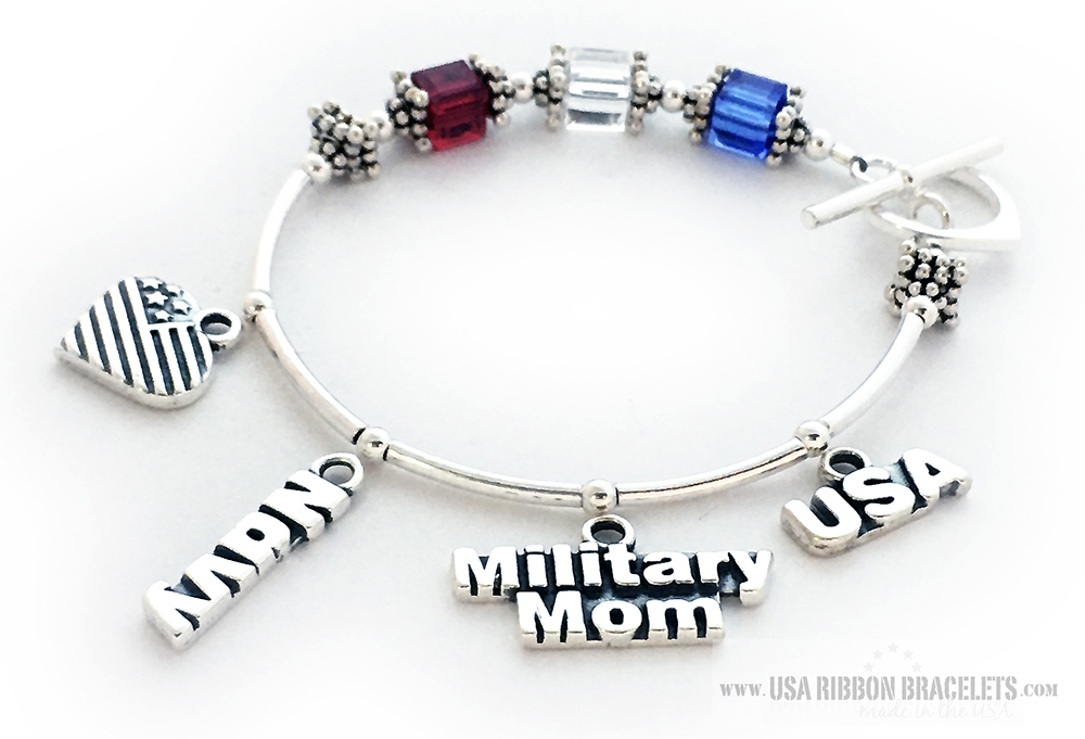 This USA-B2 Red White and Blue bracelet is shown with a Heart Toggle Clasp. They added 4 charms to their order: Heart Flag Charm, Navy Charm, Military Mom Charm and a USA Charm.