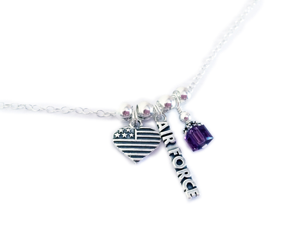 The necklace starts at $29 with no charms. They added a Heart Flag charm, Air Force charm and a February or Amethyst birthstone crystal dangle. Shown on a Rolo Chain. Everything is .925 sterling silver or Swarovski crystals.
