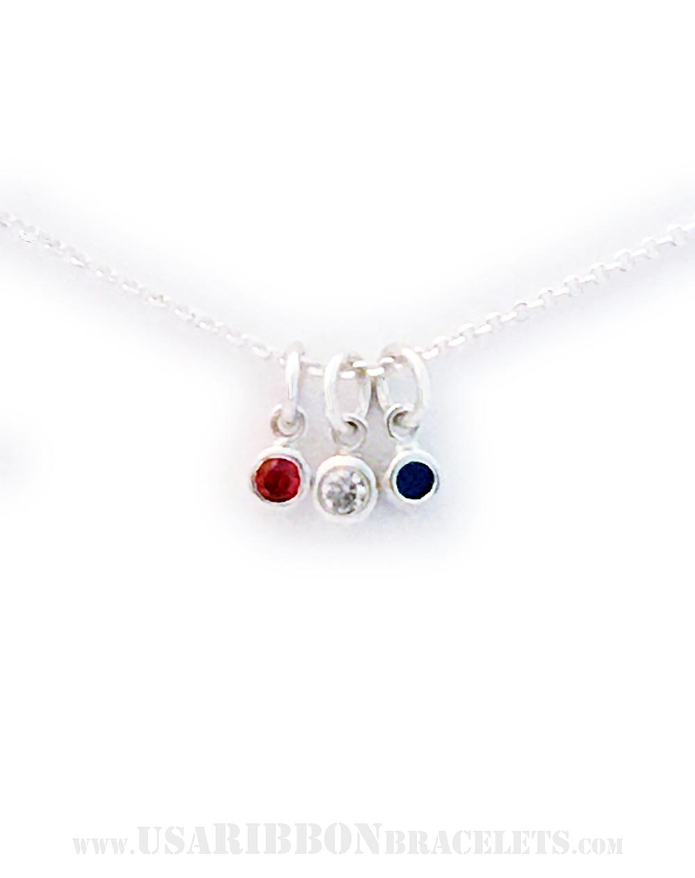 This Red White and Blue Charm Necklace is shown on a sterling silver Rolo Chain necklace.