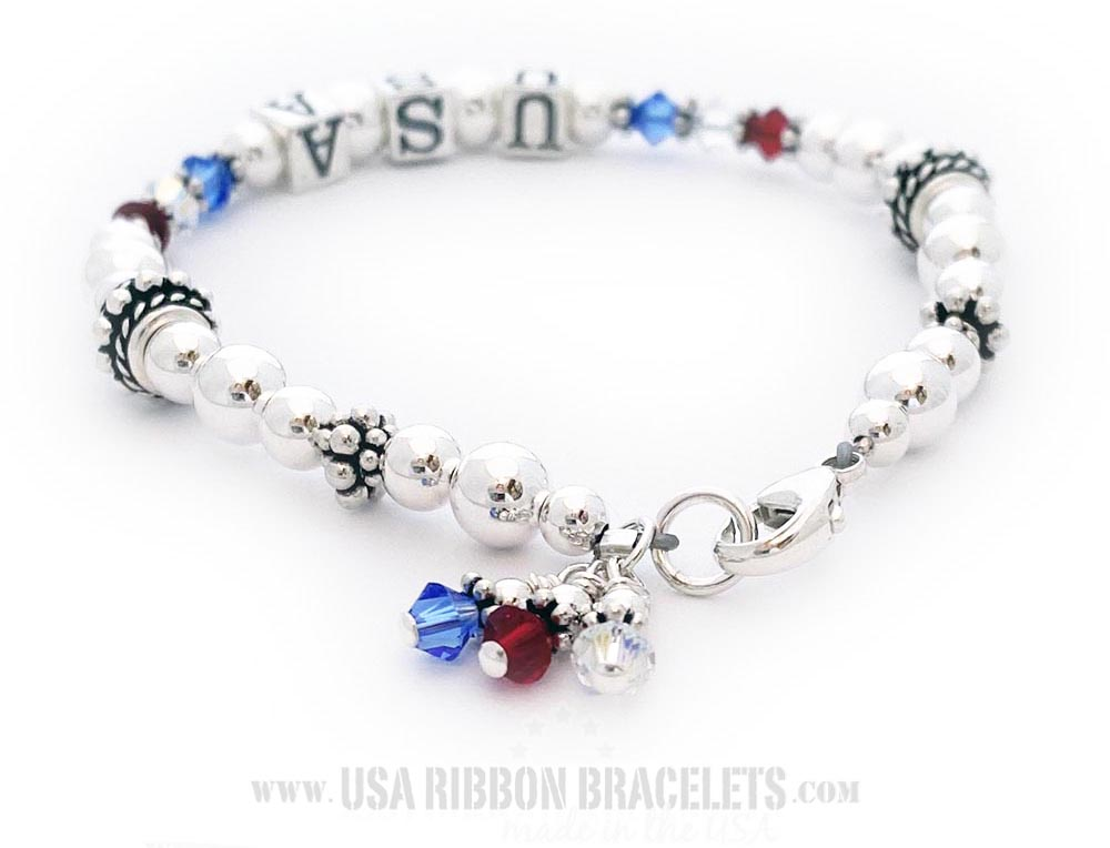 This is a beautiful USA Charm Bracelet. It includes the red, white and blue 4mm bicone crystals next to the lobster clasp. It is shown with a sterling lobster clasp but you get to choose the clasp style during the ordering process.