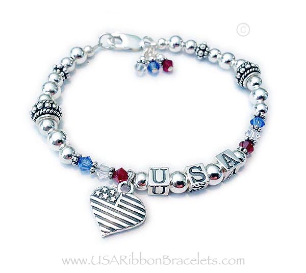 The Red White and Blue Crystal USA Charm Bracelet is shown with an add-on Heart Flag charm. Shown with one of my free lobster claw clasps.
