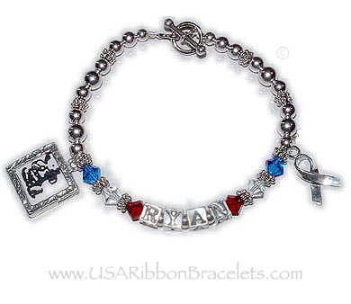 The Red White and Blue Crystal Name Bracelet is shown with 2 add-on charms: Square Textured Picture Frame and a Ribbon Charm.